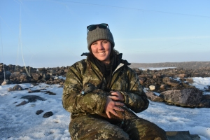 Erica Geldart with a common eiders on Mitivik Island, Nunavut, Canada.
