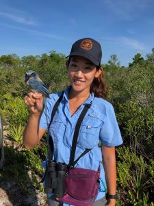 Young Ha Suh holding a Florida Scrub-Jay.